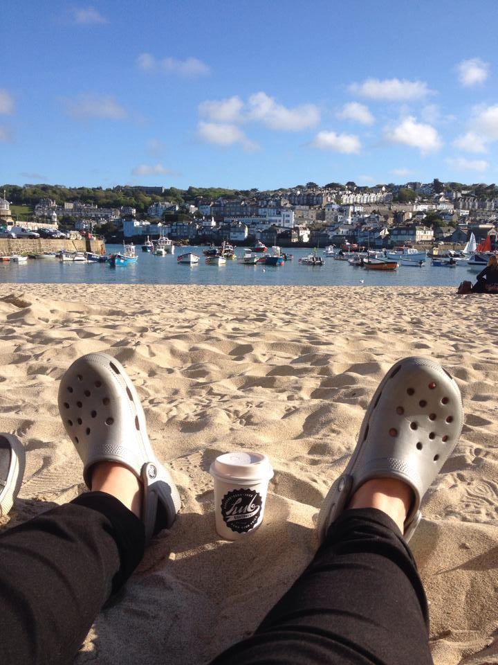 Sitting on the beach with a coffee - Web App Design and Development in St Ives Cornwall